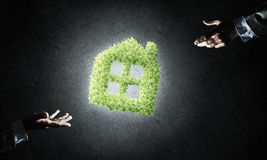 Concept of eco architecture presented by green house on dark bac Stock Photo