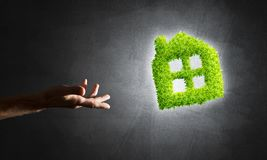 Concept of eco architecture presented by green house on dark background Stock Photography