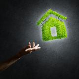 Concept of eco architecture presented by green house on dark background Royalty Free Stock Photography