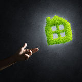 Concept of eco architecture presented by green house on dark background Royalty Free Stock Photos