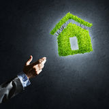 Concept of eco architecture presented by green house on dark background Stock Image