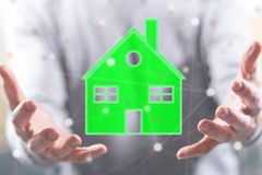 Concept of eco friendly house. Eco friendly house concept above the hands of a man in background Royalty Free Stock Photo