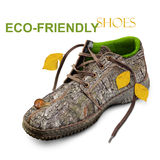 Concept. Eco-friendly shoes. Eco-friendly shoes. Concept. Shoes made of natural materials. Winter shoes from the bark of a tree, grass and leaves. Isolated over Stock Photos