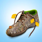 Concept. Eco-friendly shoes. Eco-friendly shoes. Concept. Shoes made of natural materials. Winter shoes from the bark of a tree, grass and leaves Royalty Free Stock Image