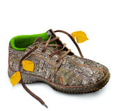 Concept. Eco-friendly shoes. Eco-friendly shoes. Concept. Shoes made of natural materials. Winter shoes from the bark of a tree, grass and leaves.  over white Royalty Free Stock Photos