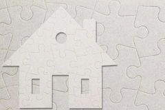 Concept of eco house on jigsaw puzzle pieces Royalty Free Stock Photo