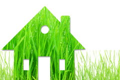 Concept of eco house with water drops on wheat grass Royalty Free Stock Images