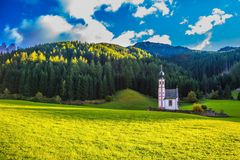 The eco-tourism in Tirol. The concept of eco-tourism in Tirol. The famous church of St. Mary Magdalene and bell tower in a mountain valley. Dolomites, Tyrol stock images