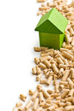 Concept of ecological and economic heating. Wooden pellets. Royalty Free Stock Photos