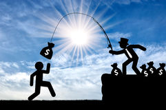 Concept of economic inequality. Rich people having fun, catching a person for money Stock Images