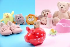 Concept for economics and children / parenting. Piggy bank with toys in the background Royalty Free Stock Photography