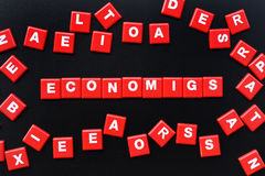 Concept of economics word. On black background Stock Images