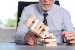 Concept of economy crash. With domino tower Royalty Free Stock Photo