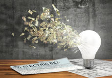 Concept of economy of energy. Money flying from the hole in lightbulb near electric bills on a concrete wall background. 3d illustration Stock Photography