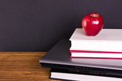 Concept education. Laptop and books Stock Image