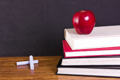 Concept education. Books and apple Stock Photo
