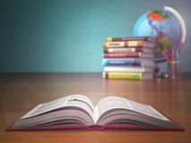 Concept of education. Open book wich pencils and globe. Stock Images