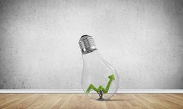 Concept of effective marketing innovations. Glass lightbulb with growing green arrow graph ine in empty room with grey wall on background. 3D rendering Royalty Free Stock Photos