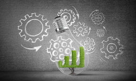 Concept of effective marketing innovations. Lightbulb with growing green graph inside placed against sketched gear mechanism on grey wall on background. 3D Stock Photo