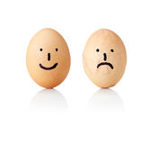 Concept eggs with painted Emoticons (smile and sad), smooth and wrinkled Stock Photo