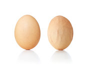 Concept eggs, smooth and wrinkled Stock Images