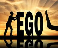 Concept of egoism as a problem in society. Gesture of the hand stop and silhouette of the man pushing the word ego. The concept of egoism as a problem in society Royalty Free Stock Images