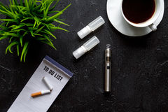Concept of electronic cigarette on dark background top view Stock Photo