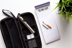 Concept of electronic cigarette on white background top view Royalty Free Stock Photo