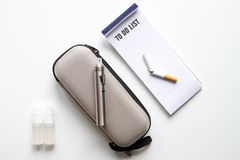 Concept of electronic cigarette on white background top view Stock Photo