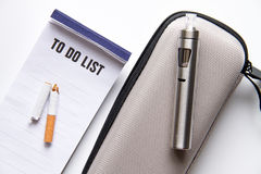 Concept of electronic cigarette on white background top view Stock Images
