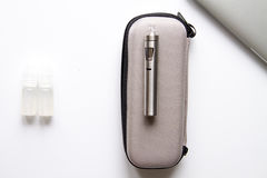 Concept of electronic cigarette on white background top view Stock Photography