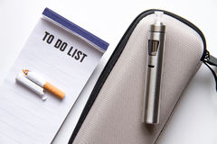 Concept of electronic cigarette on white background top view Royalty Free Stock Photography