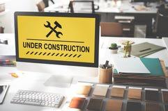 Concept en construction d'icône de panneau d'avertissement Photos stock