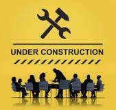 Concept en construction d'icône de panneau d'avertissement Photographie stock