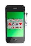 Concept en ligne de casino. Machine à sous à l'intérieur de téléphone portable Photo stock