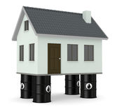 Concept of energy. Four oil barrels that support a house, concept of energy (3d render Royalty Free Stock Images