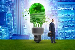 The concept of energy efficiency with lightbulb. Concept of energy efficiency with lightbulb royalty free stock photography