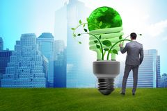 The concept of energy efficiency with lightbulb. Concept of energy efficiency with lightbulb stock photo