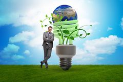 The concept of energy efficiency with lightbulb royalty free stock image