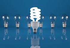 Concept of energy saving. Eco light bulb in row of incandescent Stock Images
