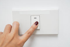 Concept of energy saving by turn the light off Royalty Free Stock Photos