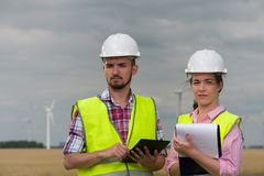 Concept of engineers and windmills stock photography