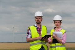 Concept of engineers and windmills royalty free stock image