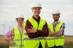 Concept of engineers and windmills stock image
