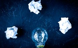 Concept enlightenment solution on dark background top view.  stock photos