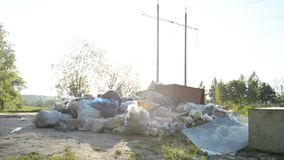 Concept of environmental pollution by construction and plastic waste of human activity. Hd landscape view stock footage