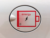The concept of environmentally friendly fuel. Sign of the electric charge on the battery cover of tank car Stock Image