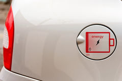 The concept of environmentally friendly fuel. Sign of the electric charge on the battery cover of tank car Stock Images