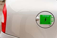 The concept of environmentally friendly fuel. Sign of the electric charge on the battery cover of tank car Royalty Free Stock Images