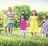 Concept espiègle de bonheur de Friendness d'amis de parc d'enfants Photo stock